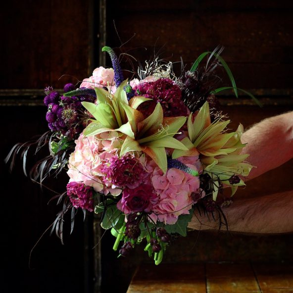 Bride's bouquet with amaryllis and other spring flowers.